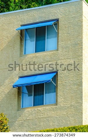 Nice looking windows at the side wall  of the house. - stock photo