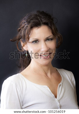 Nice looking woman giving a big smile.