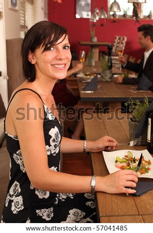 nice lunch for a pretty girl in a restaurant - stock photo