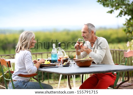Nice lunch in countryside with beautiful panorama - stock photo