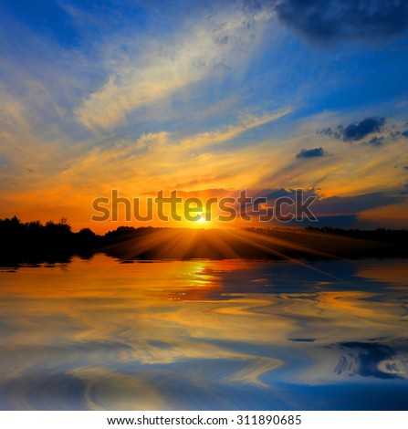 Nice majestic sunset over lake - stock photo