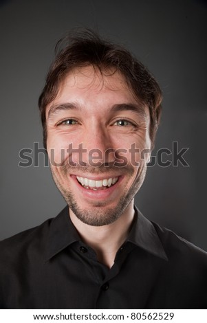 nice man in a black shirt with the beard poses funny faces - stock photo