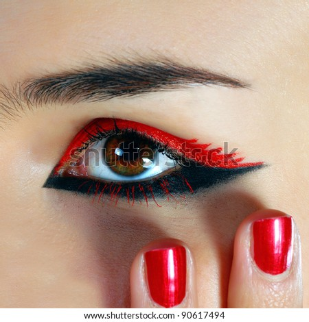 nice manicure and a beautiful girl eye - stock photo