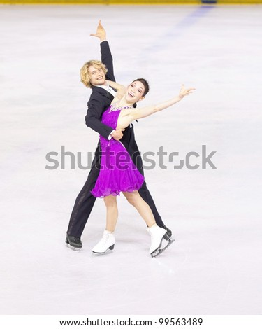 NICE - MARCH 27: American ice dancers Meryl Davis and Charlie White skate during official practice at the ISU World Figure Skating Championships, held on March 27, 2012 in Nice, France - stock photo