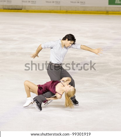 NICE - MARCH 26: Canadian ice dancers Kaitlyn Weaver and Andrew Poje skate during official practice at the ISU World Figure Skating Championships on March 26, 2012 in Nice, France - stock photo