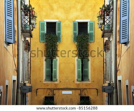 Nice mediterranean house facades with different colours - stock photo