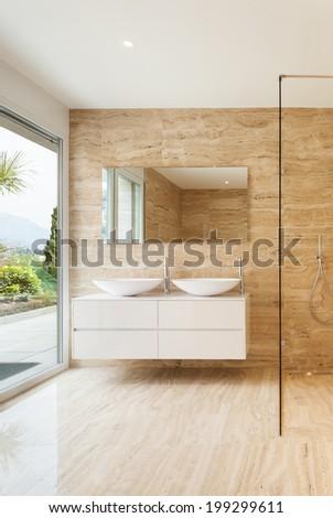 nice modern bathroom, marble walls - stock photo