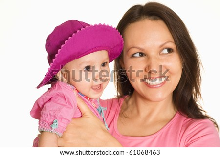 nice mom s tands and holds the baby - stock photo
