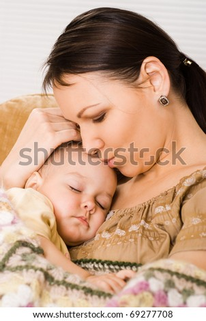 nice mother sitting and holds the baby