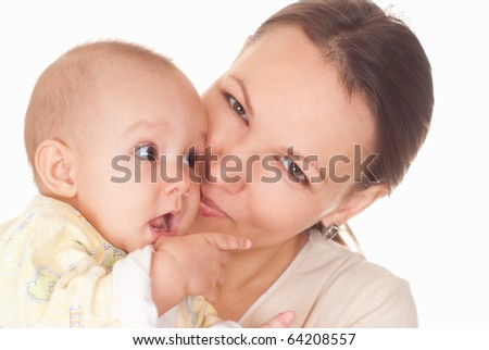 nice mother stands and holds the baby
