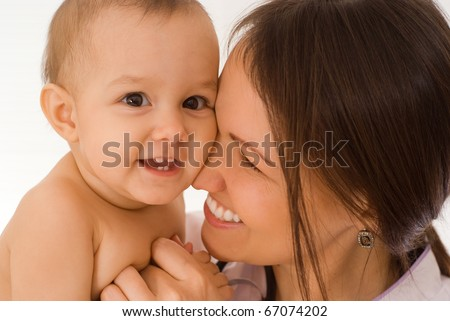 nice mother stands and holds the baby - stock photo