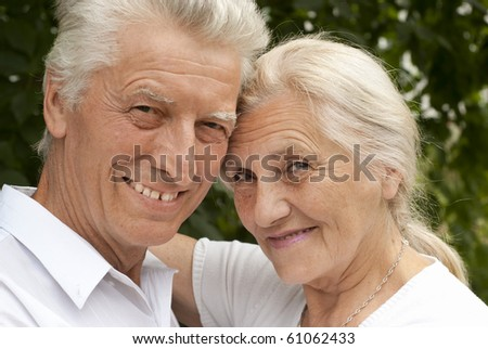 nice old couple in a summer park