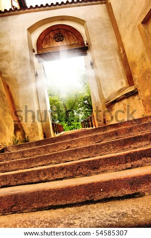 nice old gate vith sun light - stock photo