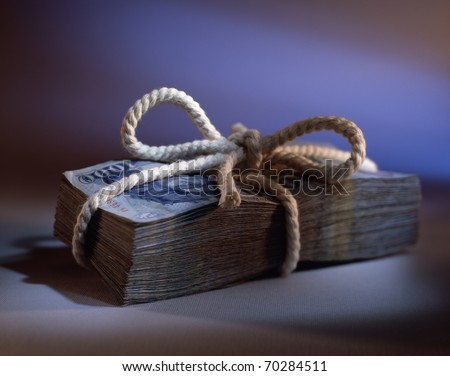 nice old money bunch with a bow - stock photo