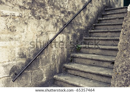 Nice old outdoor staircase Croatia. Image is cross processed to reflect age and time.
