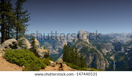 Nice Pano Image of Half dome from Glacier point showing Vernal and nevada falls - stock photo