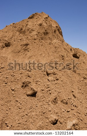 Nice pile of clean soil ready for fill or the garden. - stock photo