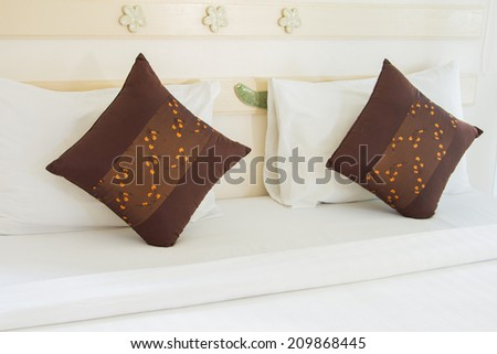 Nice pillows on a contemporary bed - stock photo