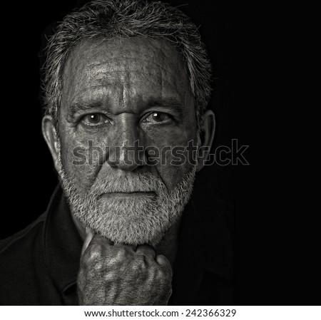 Nice portrait of a successful Latino Man on Black - stock photo