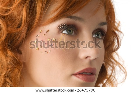 nice portrait of beautiful red haired girl with creative makeup