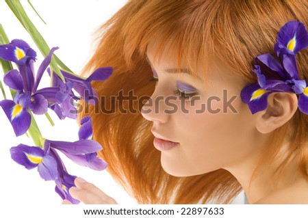 nice portrait of beautiful young model laying near violet flower