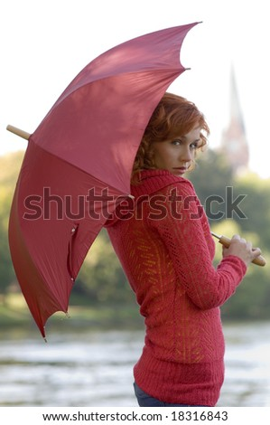 nice portrait of cute woman with hair pullover and umbrella in red color