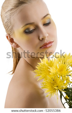 nice portrait of young cute girl with color make up and some yellow flower