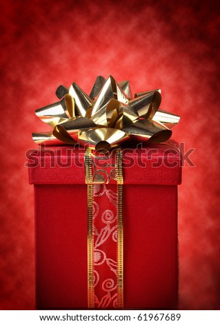 nice red and gold christmas gift, red background