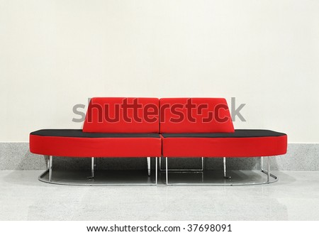 Nice red chair in hall, white wall background