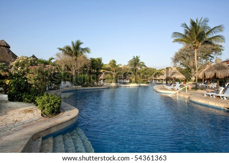 Nice resort pool on sunny day - stock photo