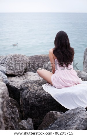 Nice romantic young woman near waterfront