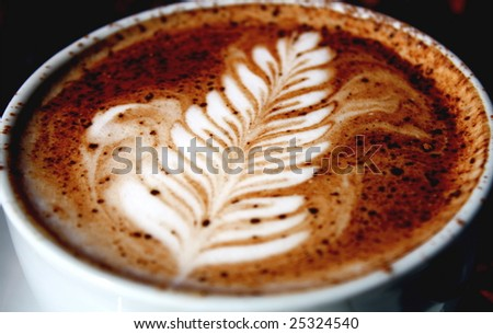 Nice rosetta in a Cafe Mocha. - stock photo