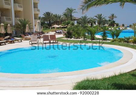 nice  round Jacuzzi swimming pool  in the Tunisia  resort - stock photo