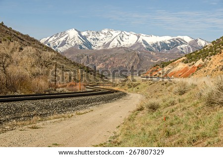 Nice S-curve in the railroad tracks as they head toward the mountains - stock photo