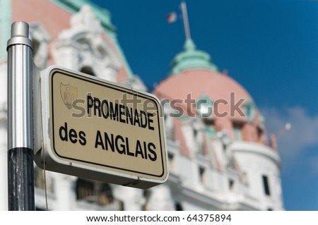 Nice's Promenade des Anglais street sign against an old building's facade, Nice Cote Azur, France - stock photo