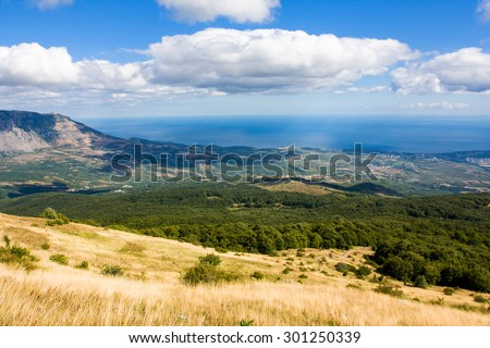Nice scene with meadow in mountains - stock photo