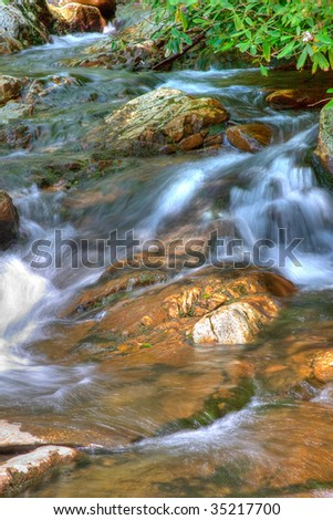 nice scenic view of a waterfall with silky smooth water - stock photo