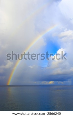 Nice seascape with rainbow in the Indian Ocean (vertical)