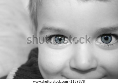 Nice shot of young boy/ Eyes picked out in sharp colour focus over desat blur.