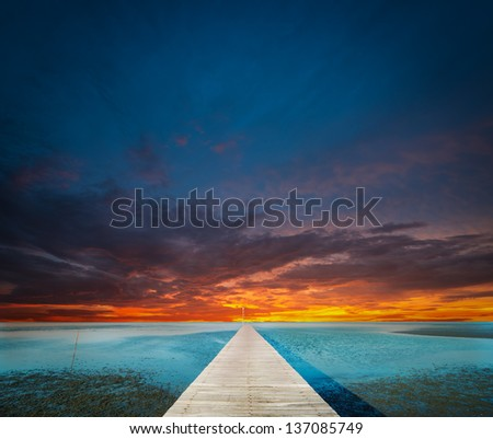nice sky with pier on the foreground - stock photo