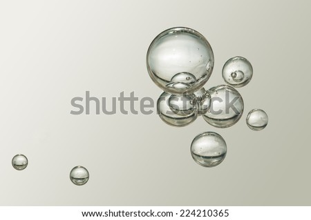 Nice small air bubbles over a blurred background - stock photo