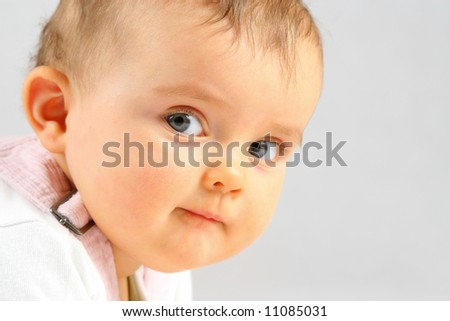 nice small baby girl looking at the camera - stock photo