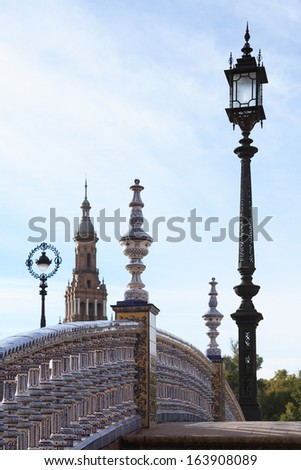 Nice small bridge and street lamps on Spain Square in Seville,Spain