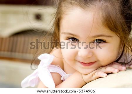 Nice small girl looking at camera - stock photo