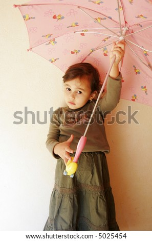 Nice small girl with umbrella
