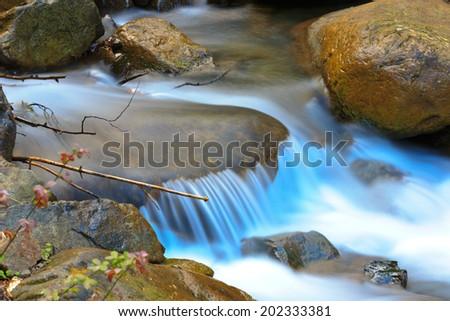 Nice small waterfall on mountain brook - stock photo