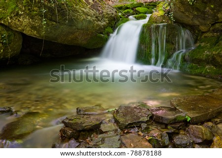 nice small waterfall on mountain stream - stock photo