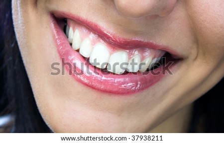 Nice smile with healthy white teeth - stock photo