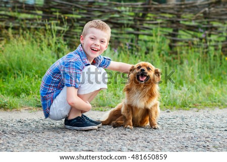 nice smiling boy with a smiling dog.Best friends. Outdoor
