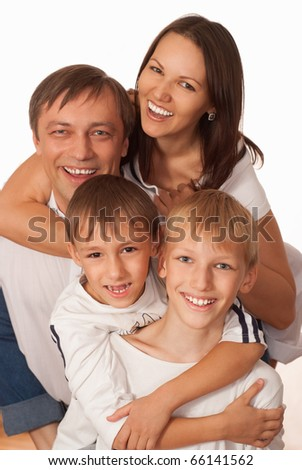 nice smiling family of four on a light background